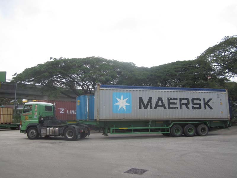 tobe011b Trucking stuffed 40ft open top container for export